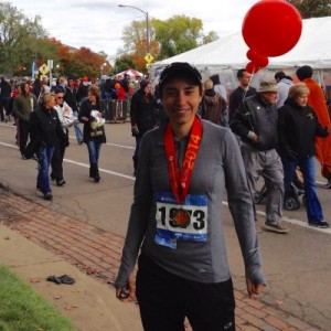 Elizabeth wearing her Twin Cities Marathon finisher's medal