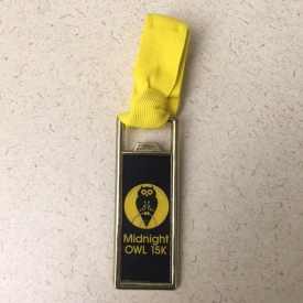 Midnight Owl 15K finishers medal