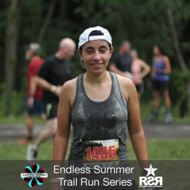 Endless Summer Trail Run Series finish line photo of Elizabeth