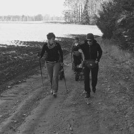 Jen, Cory, and Jess pulling wagons and hiking up hill