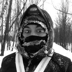 Frost freezing on my eyelashes and face mask