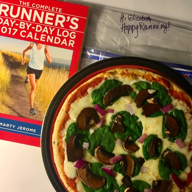 A runner's calendar and veggie pizza
